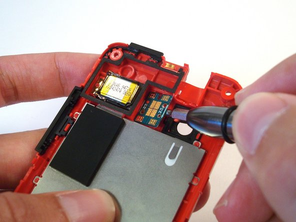 Use a small flathead screwdriver to gently pry the dual LED flash board off the posts holding it to the rear inner frame.
