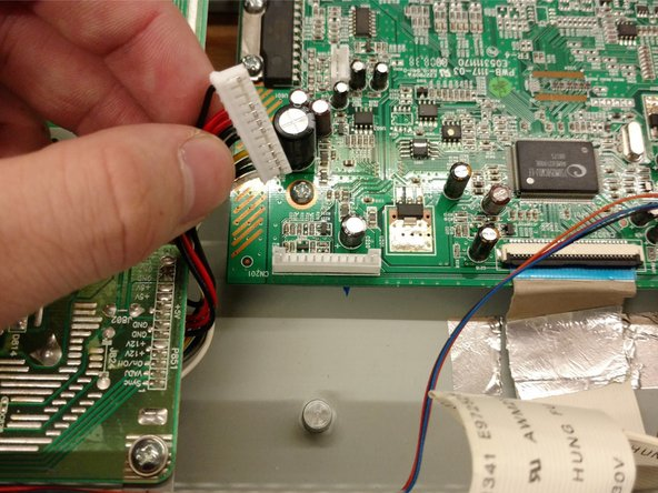 Image 1/1: Remove the cables connecting the power supply to the display port.