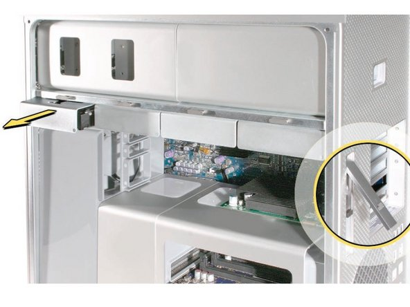Image 1/1: Then, remove all 4 of the drive bays and set them aside.