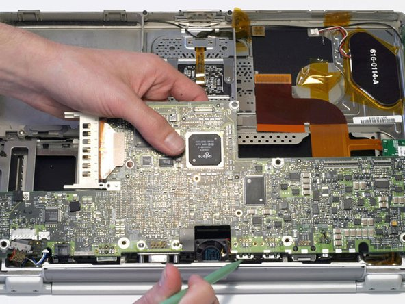 Carefully lift the logic board up and pull it away from you. The logic board may catch on the back panel ports liner. If this occurs, use a spudger or non-metal tool to free the logic board.