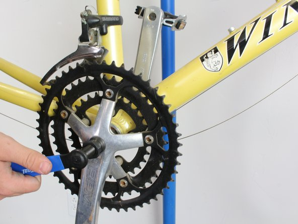 Once the movable piece is tightened firmly inside the hole, turn the tool clockwise.  This will pull the crank arm away from the bike and remove it completely.