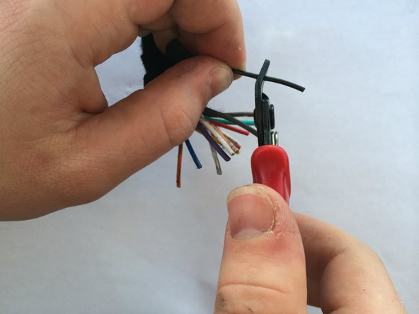 Strip each wire in the wiring harness necessary for installation.