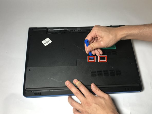 Locate the tabs that hold the base cover to the laptop and use a plastic opening tool to gently release the base cover.