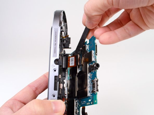 Holding the Vita on its side, use a spudger to gently pry off the OLED connector from the motherboard.