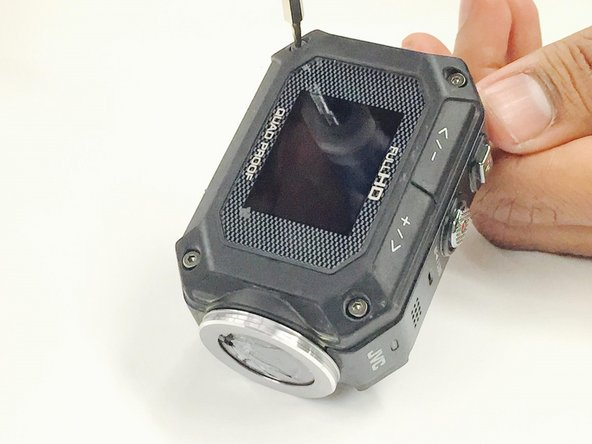 Using a 1x1xH1.5 torx screwdriver,  remove the 8 screws (5mm headsize / 4mm length) from the corners of both the front and back of the camera (4 screws on each side).