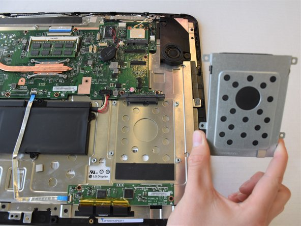 Gently pull the hard drive away to disconnect it from the motherboard.