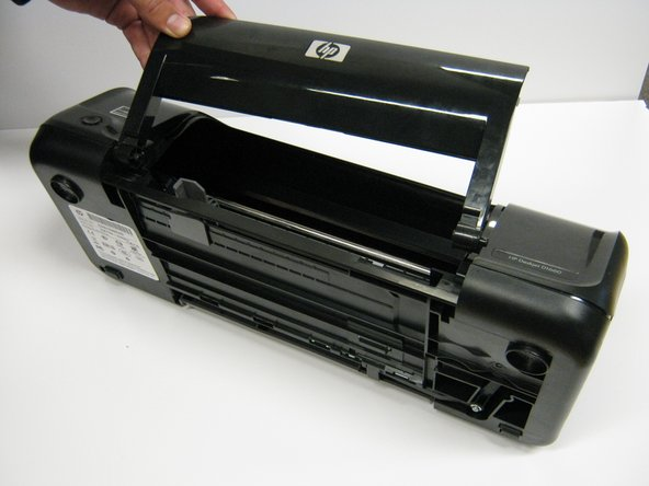 Image 1/1: Similar to the paper tray, grab it from the right side and pull it to the left and up.