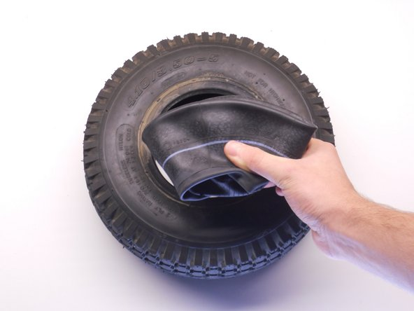 Take the replacement inner tube and spread it out with your hands.