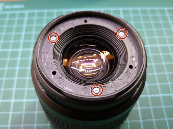 Unscrew the 3 screws that hold the front lens assembly to the rest of the lens.