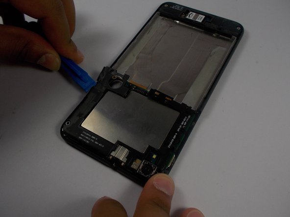 Remove the black plastics casing surrounding the motherboard with a plastic opening tool.