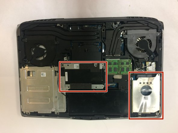 With the laptop flipped over, cover removed, and battery removed; continue by locating your hard drive(s).