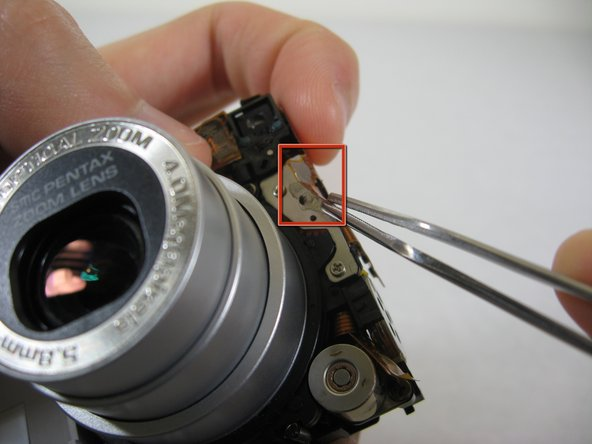 Image 1/2: Carefully peel off orange wire tape. The tape is glued to the surface indicated.