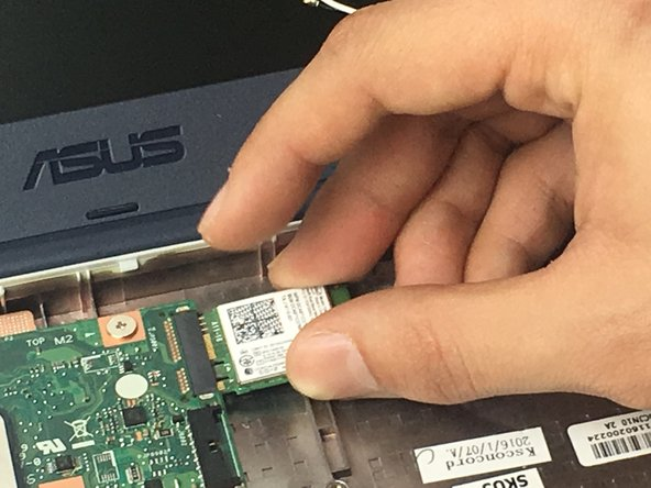 Gently pull the wireless card away from the motherboard.