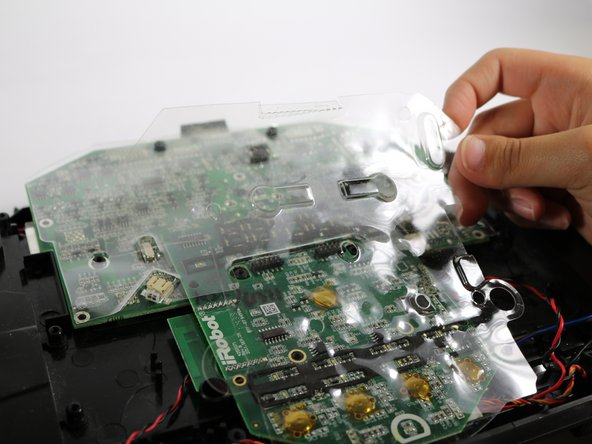 Remove the two plastic coverings that further protect the motherboard.