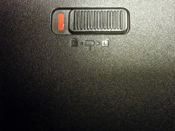Slide battery lock to unlocked position on left side, then hold it in on the right side while sliding the battery out.