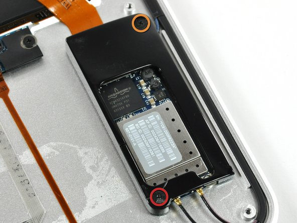Remove the two following screws securing the AirPort/Bluetooth board bracket to the upper case: