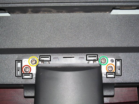 This monitor never came with a hinge cap. If yours still has it, snap it off from the points marked in black.