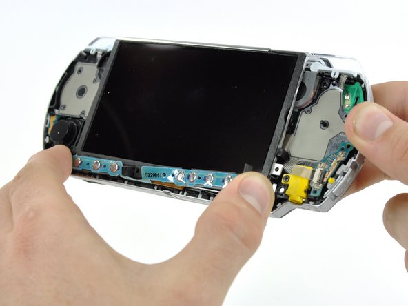 Do not attempt to remove the home bar yet, it is still attached to the PSP 300xc.