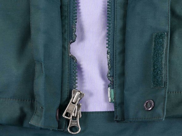 The teeth on this zipper are melted.