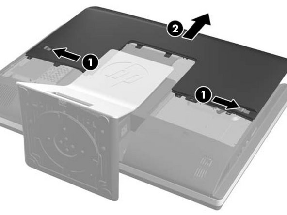 To remove the cover:  slide the latches on the right and left sides of the back cover towards the edges of the unit, then slide the cover towards the top of the computer until it slides off the unit.