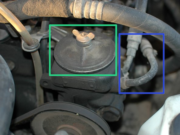 Inspect the power steering fluid reservoir cover for leaks.