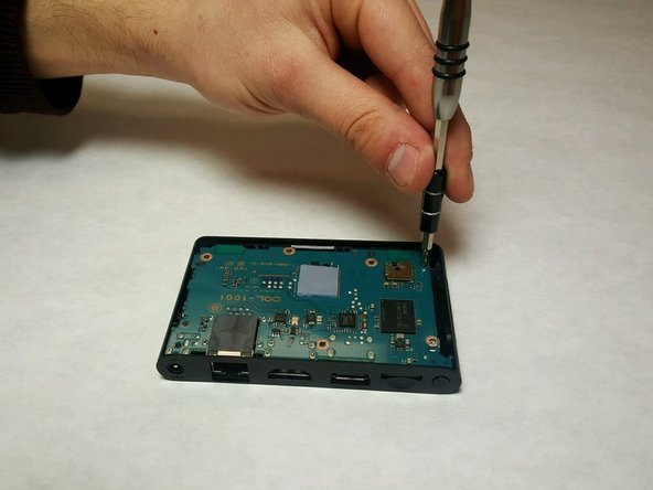 Remove the last 6mm Phillips #0 screw from the motherboard.