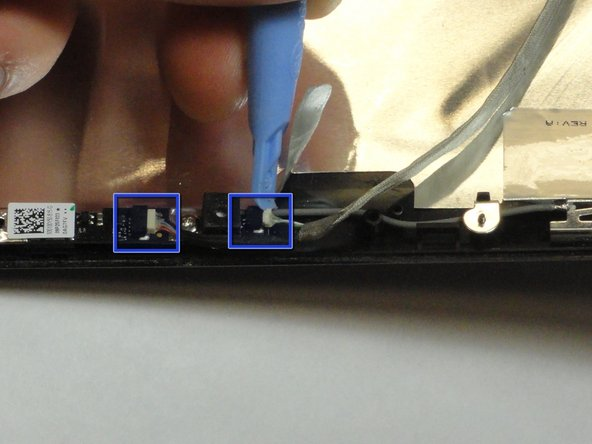 Use a plastic opening tool to loosen and remove the two connections at the top end of the wire with a thick silver covering.