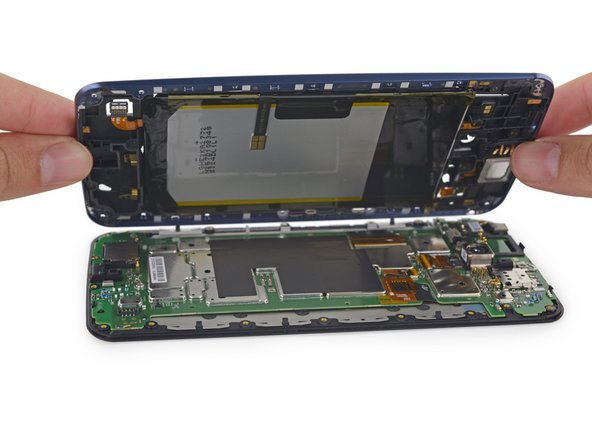 Image 1/2: With cables decoupled, it's suddenly delightfully apparent why there were so many screws in the midframe. The Nexus 6 practically falls apart into two halves; the midframe/battery assembly, and the display/motherboard assembly.