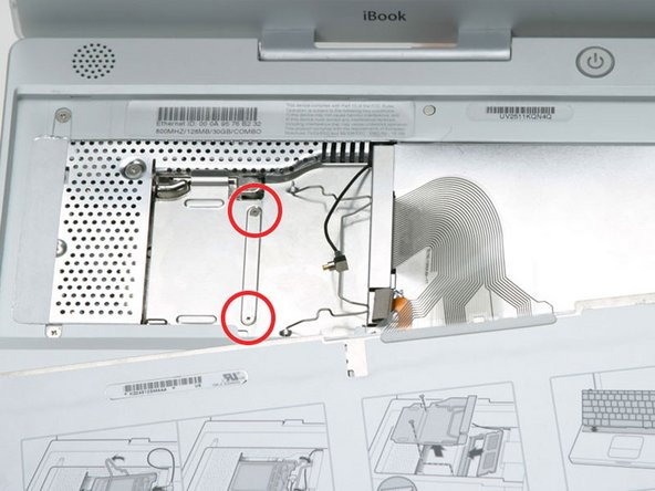 Remove the two 2.5 mm Phillips screws that secure the RAM shield.