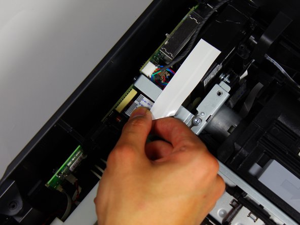 Remove the connector that binds the cartridge access door to the motherboard by pinching the blue part of the connector with two fingers and pulling it away from the motherboard.