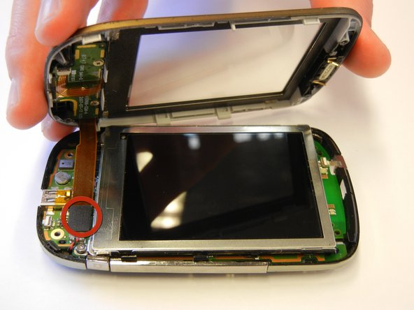 Be sure to unplug the front button cable from the inside of the phone.