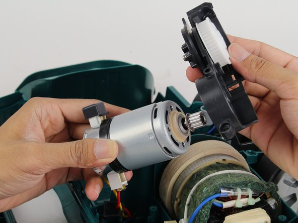Remove the belt-assembly unit by pulling the belt-assembly unit away from the motor.