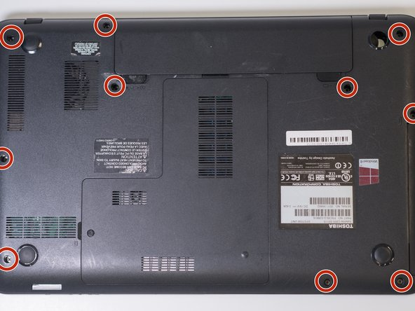 Remove the ten 7mm screws located on the bottom of the laptop using the J1S screwdriver.