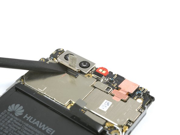 Use a spudger, to disconnect the rear camera flex cable.