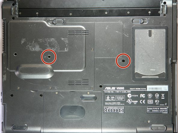Using a screw driver, remove these two screws from the case.