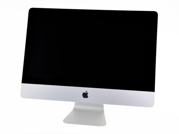 "Image 1/1: Introducing the new 21.5"" iMac, now featuring additional features such as a Thunderbolt port and a quad-core processor."
