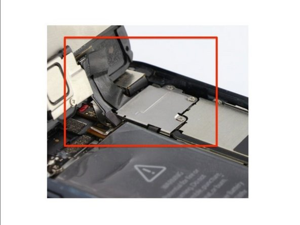 CAUTION: Do not try to completely remove the display assembly from the frame! There are three flex cables still attached to the top of the iPhone, and removing the display at this stage can destroy them.