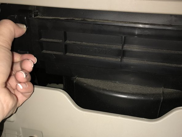 Once the glove box is loose, locate latches, on the left and right top and bottom corners, and pinch together, at the same time, to free the air filter.