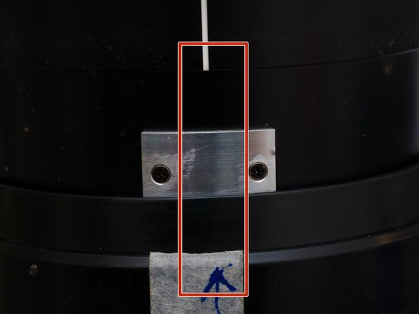 Rotate the rear half of the lens, towards close-up direction (CW as looking downwards), pass 8m/25 feet mark and continue, while applying gentle force pulling rear part up, until they separate, mark the point.