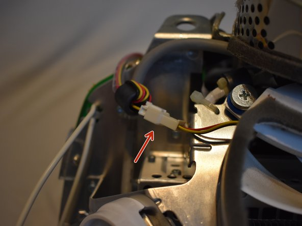To remove the fan assembly, several cables must be disconnected first: