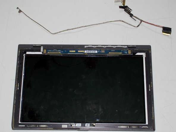 Disconnect the LCD connector from the screen housing by pulling the connector.