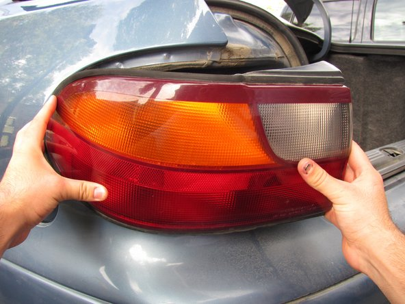 When the tail light assembly comes loose, do not fully remove it because it may damage the connected wires.