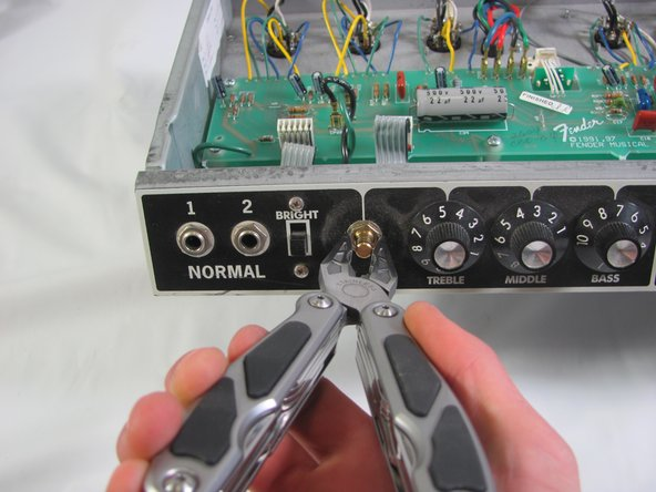 Start by removing all the knobs with a small, flat screwdriver