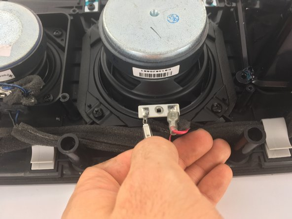 Image 3/3: Disconnect the red and black wires by pulling gently on the rubber ends attached to the connectors.