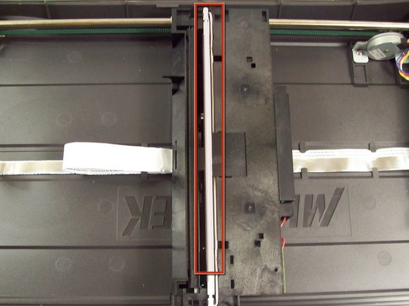 After opening the chassis, you will see a white bulb spanning the width of the scanner.