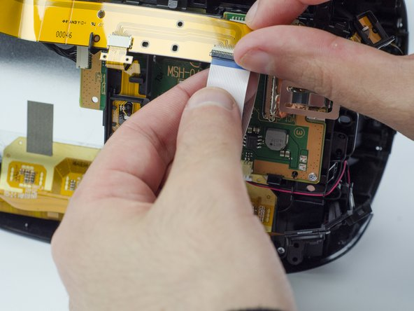 Image 1/3: Carefully pull the end of the white ribbon connector from its slot.