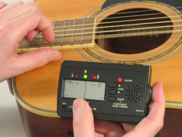 Use a guitar tuner to check the tune of the string. Adjust accordingly until the string is properly tuned.