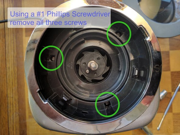Using a #1 Phillips Screwdriver remove each of the three top screws and set them aside.