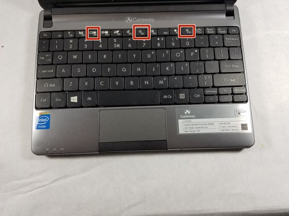 Once the battery is removed, flip the laptop over and open it up so you can see the keyboard.