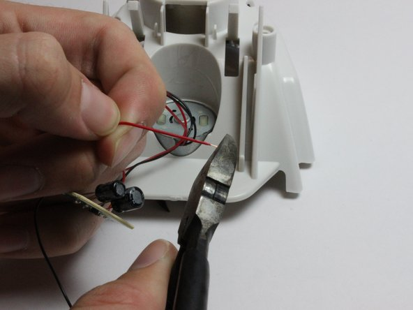 The wires are very thin, so take care not to cut through them.